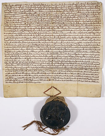 The Charter of the Forest, 1217, held by the British Library Forest-charter-1225-C13550-78.jpg