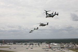 Marine Corps Air Station New River - From right, a V-22 Osprey, a CH-53E Super Stallion, a CH-46 Sea Knight, a UH-1N Huey, and an AH-1 Cobra fly in formation over Marine Corps Air Station New River, North Carolina, March 18, 2008.