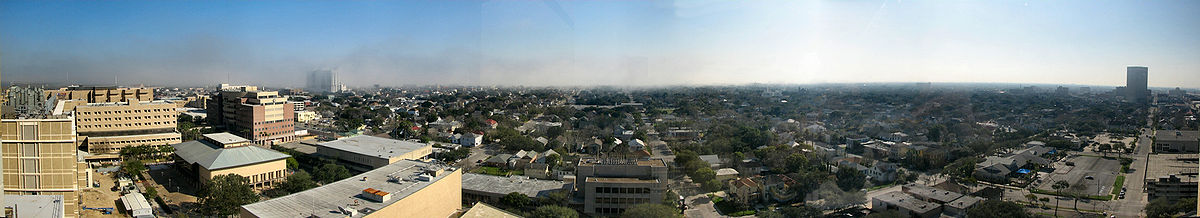 The city of Galveston looking southeast toward the Gulf of Mexico. Downtown Galveston and the Strand Historic District are at the far right, while East Beach and the University of Texas Medical Branch Children's Hospital and Shriners Children's Burns Hospital are to the far left.