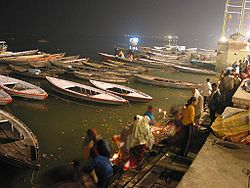 People performing Hindu ceremony at one of the ghats of Varanasi