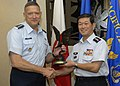 General Gary North, Pacific Air Forces commander, exchanges a gift with General Kenichiro Hokazono, Japan Air Self-Defense Force chief of staff at Hickam AFB.jpg