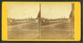 General view with, road, buildings, and smokestacks in the distance, by T. E. M. White.png