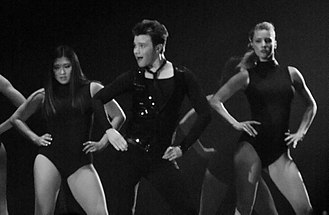 "Chris Colfer - Jenna Ushkowitz, Colfer and Heather Morris during a performance of ""Single Ladies"" on the tour Glee Live! In Concert! in 2011"