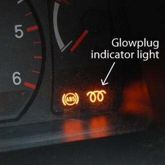 "Glowplug - ""Wait-to-Start"" light (glowplug indicator light, ISO 7000-0457) in a diesel car."