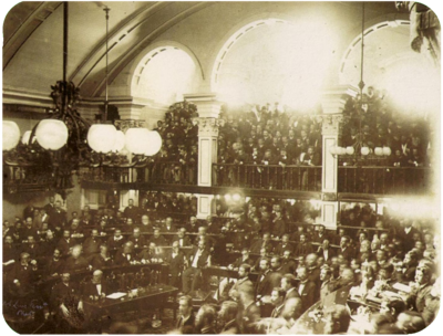 Brazilian Senate, 1888. The senators are voting on the Golden Law as a large crowd watches in the background Golden law 1888 Brazilian senate.png