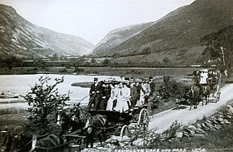 "Charabanc - Charabancs on the ""Grand Tour"" connecting the Corris Railway to the Talyllyn Railway, passing Tal-y-llyn Lake around 1900"