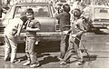 """Group of cub scouts washing cars. Car in centre is a Chevrolet with a bumper sticker reading """"Come join our world, fly with the Eagles"""". (3778262600).jpg"""