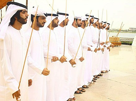 A band performs a razfah in an Emirati wedding. Razfah is a cultural dance derived from Arab tribes sword battles. Haribya Band.jpg