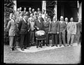 Herbert Hoover cutting large melon, with group LCCN2016888992.jpg