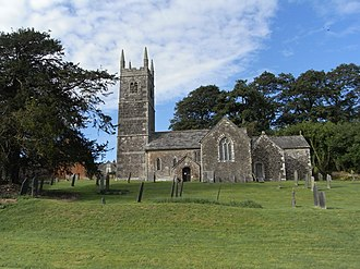 Tetcott - Holy Cross Church, Tetcott, Devon, viewed from south. Behind the church is Tetcott Manor House.