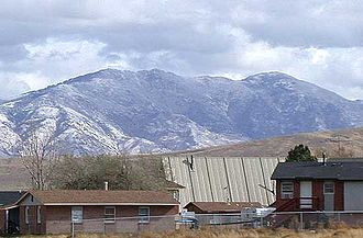 Fort Hall Indian Reservation - Houses in the town of Fort Hall, with the Portneuf Range in the background