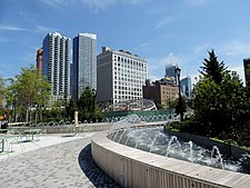 Hudson Pk fountain and 36 St bldgs jeh.JPG