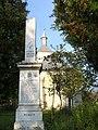 I. világháborús emlékmű (1942) és a református templom, Bogártelke1.jpg
