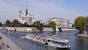 """Bateaux Mouches - A """"Bateau Mouche"""" excursion boat on the Seine near the Île de la Cité."""