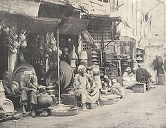 In the Bazaar of the Cauldron Sellers. (1918) - TIMEA.jpg