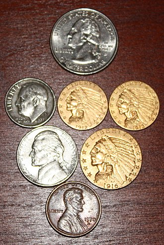 Indian Head gold pieces - Examples of the Indian Head gold pieces grouped with modern coins for size comparison purposes