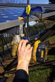 Installing solar panels (3078006982).jpg