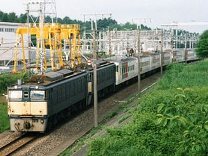 185 series - 185-200 series EMU running in multiple with a pair of EF63 locomotives between Yokokawa and Karuizawa in July 1997