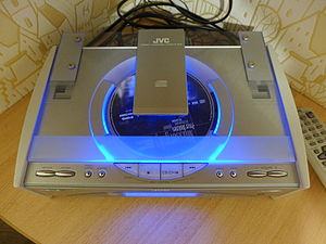 CD player - A JVC FS-SD5R CD player from the 1990s with a see-through plastic cover.