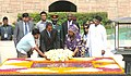 Jakaya Kikwete and the First lady of Tanzania, Mrs. Salma Kikwete laying wreath at the Samadhi of Mahatma Gandhi, at Rajghat, in Delhi. The Minister of State for Agriculture.jpg