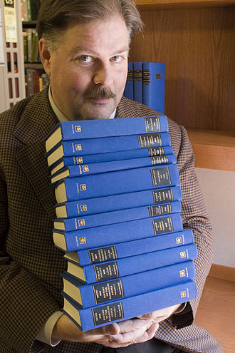 James Hankins - Professor James Hankins holds a collection of books from the I Tatti Renaissance Library