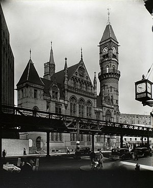 Jefferson Market Library - Jefferson Market Court in 1935, with the IRT Sixth Avenue Line in front of it.  Photograph by Berenice Abbott (1935)