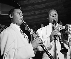 Harry Carney - Jimmy Hamilton and Harry Carney, Aquarium NYC, c. November 1946.  Photography by William P. Gottlieb.
