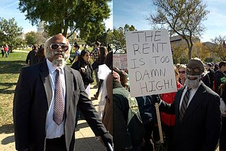 Jimmy McMillan - McMillan's significant media coverage spawned imitators, such as these two men at the Rally to Restore Sanity and/or Fear in Washington, D.C.