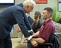 Joe Biden speaks with wounded warrior Marine Corps Sgt. James Amos, 2012.jpg