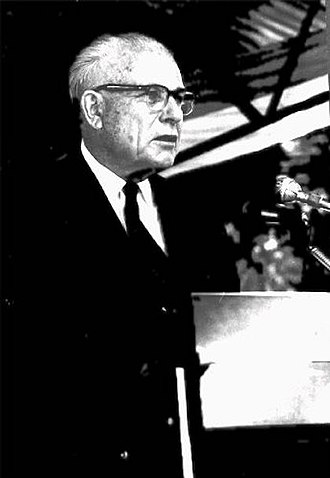 John A. Hannah - Dr. John A. Hannah, presenting a statement at the ceremony celebrating the 100 Millionth Smallpox Vaccination Under the Agency for International Development (AID) Program in Africa, 1969.
