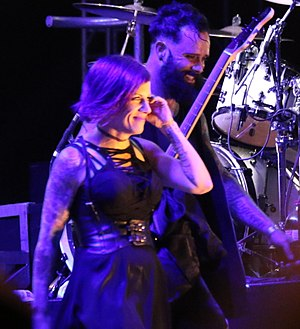 John Cooper (musician) - Cooper walking off stage with his wife Korey in 2017