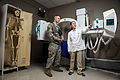 Joni Garcia Hunter, a physical therapy assistant with the health and wellness division at the Argonne National Laboratory, explains different components of an X-ray machine to U.S. Army Spc. Kevin Thomas 140826-A-TI382-049.jpg