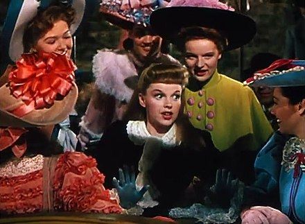 Judy Garland and the chorus performing The Trolley Song, a song inspired by a picture of a tram in a turn-of-the-century newspaper. Judy Garland in Meet Me in St Louis trailer 2.jpg