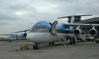 AirUK - A KLM uk BAe 146 with a company Fokker 50 behind at London City Airport in 1999.