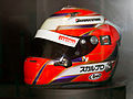 Kamui Kobayashi 2010 helmet Suzuka RacingTheater.jpg