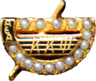 Crown Pearl Badge of Kappa Kappa Psi.