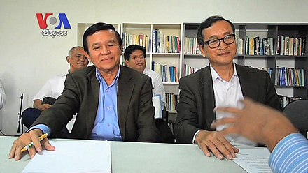 Cambodia's deputy opposition leader Kem Sokha (left) has been arrested in September 2017 while opposition leader Sam Rainsy (right) has lived in exile since November 2015 Kem Sokha with Sam Rainsy.jpg