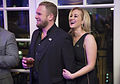 Kyle Jacobs and Kellie Pickler listen to the band Interstate 10 160204-D-PB383-482.jpg