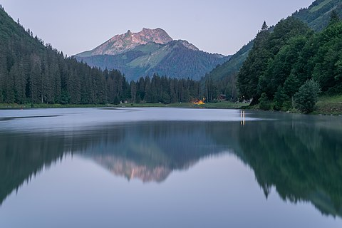 Lac de Montriond in commune of Montriond (Roc d'Enfer in the background), Haute-Savoie, France