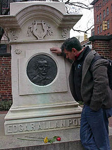 Levi Asher at grave of Edgar Allan Poe in Baltimore, Maryland