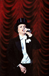 Madonna wearing a tuxedo and hat