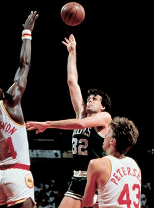 Kevin McHale (basketball) - Kevin McHale shoots over Hakeem Olajuwon and Jim Petersen during the 1986 NBA Finals.