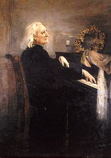 An old man with long hair, wearing a cassock, playing the piano