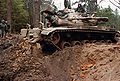 M728 Combat Engineer Vehicles clears a road.jpg