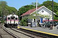 MBTA 1631 and former Manchester freight house, May 2012.JPG