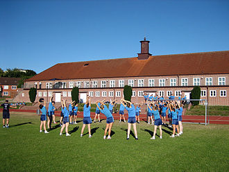 Demographics of Germany - Cadets of the German Navy exercising in front of one of the gyms of Germany's naval officers school, the Marineschule Mürwik.