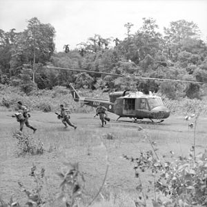 Indonesia–Malaysia confrontation - Sarawak Rangers (present-day part of Malaysian Rangers) comprising Ibans leap from a Royal Australian Air Force Bell UH-1 Iroquois helicopter to guard the Malay–Thai border.