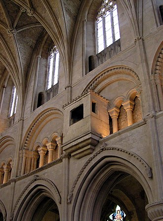 Clerestory - Malmesbury Abbey, Wiltshire, England. The nave wall is divided into three stages: the upper stage with windows is the clerestory, beneath it is the triforium, and the lowest stage is the arcade.