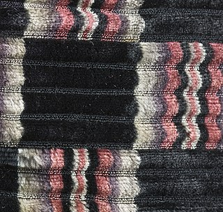 woven fabric in which a pile is produced above the ground by the use of a separate pile warp or pile weft