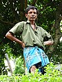 Man in Garden - Bandarawela - Hill Country - Sri Lanka (13934747610).jpg